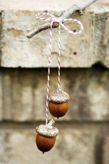 Source: https://www.etsy.com/listing/81453331/3-sets-of-golden-acorns-ornaments